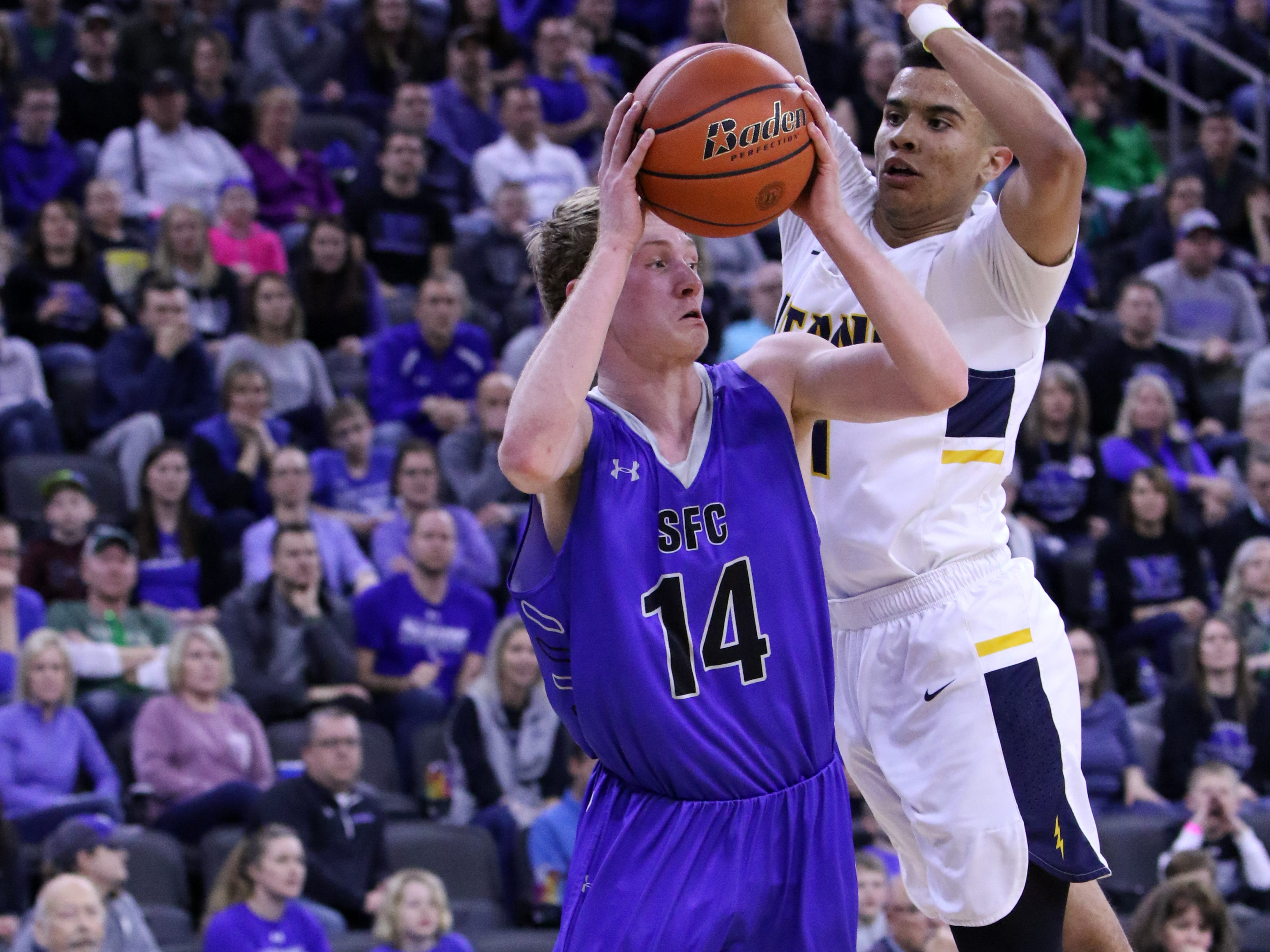 Gavin Schipper of Sioux Falls Christian has his shot blocked by Justin Hohn of Tea Area during Saturday's Class A title game at the Premier Center.