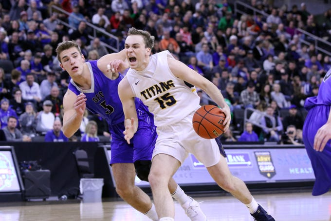 Noah Freidel of Tea Area drives the lane against Mitchell Goodbary of Sioux Falls Christian during Saturday's Class A title game at the Premier Center.