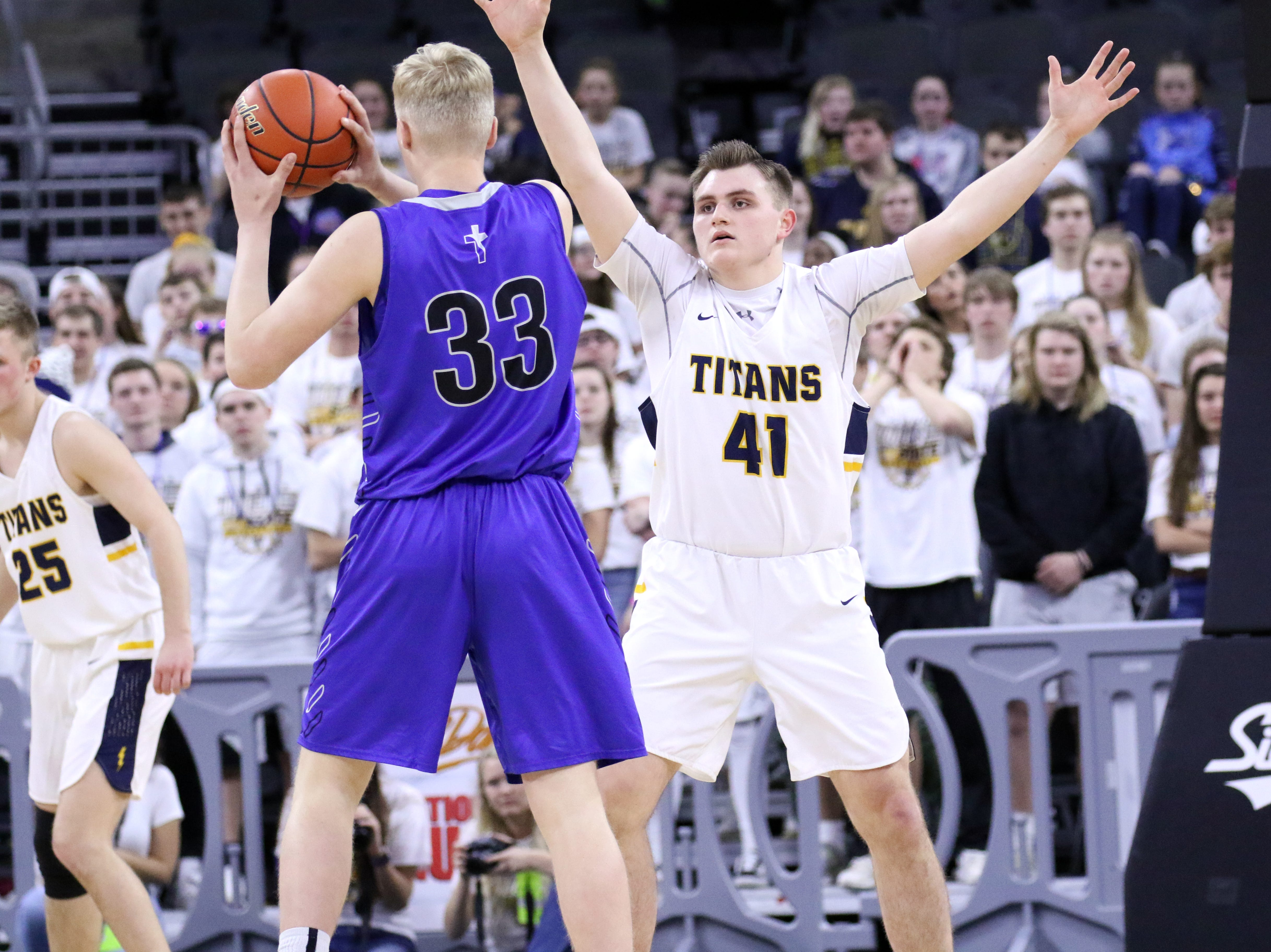 Kaleb Joffer of Tea Area applies defensive pressure to Zach Witte of Sioux Falls Christian during Saturday's Class A title game at the Premier Center.