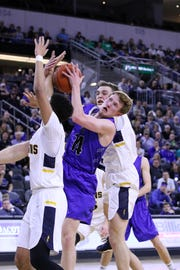 Gavin Schipper of Sioux Falls Christian tangles with several Tea Area player for a rebound during Saturday's Class A title game at the Premier Center.
