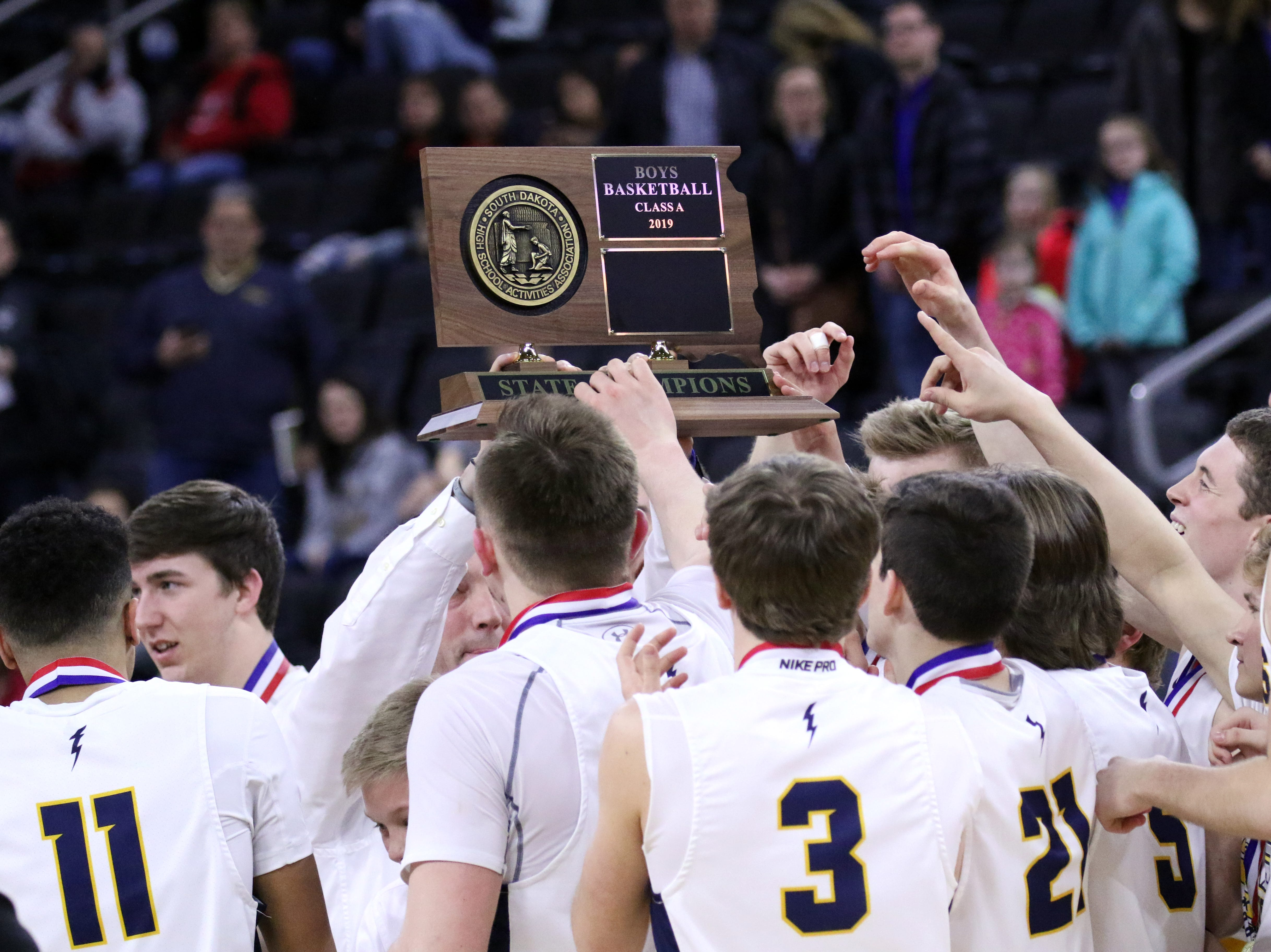 Tea Area players hold the Class A championship trophy after defeating Sioux Falls Christian on Saturday night at the Premier Center.