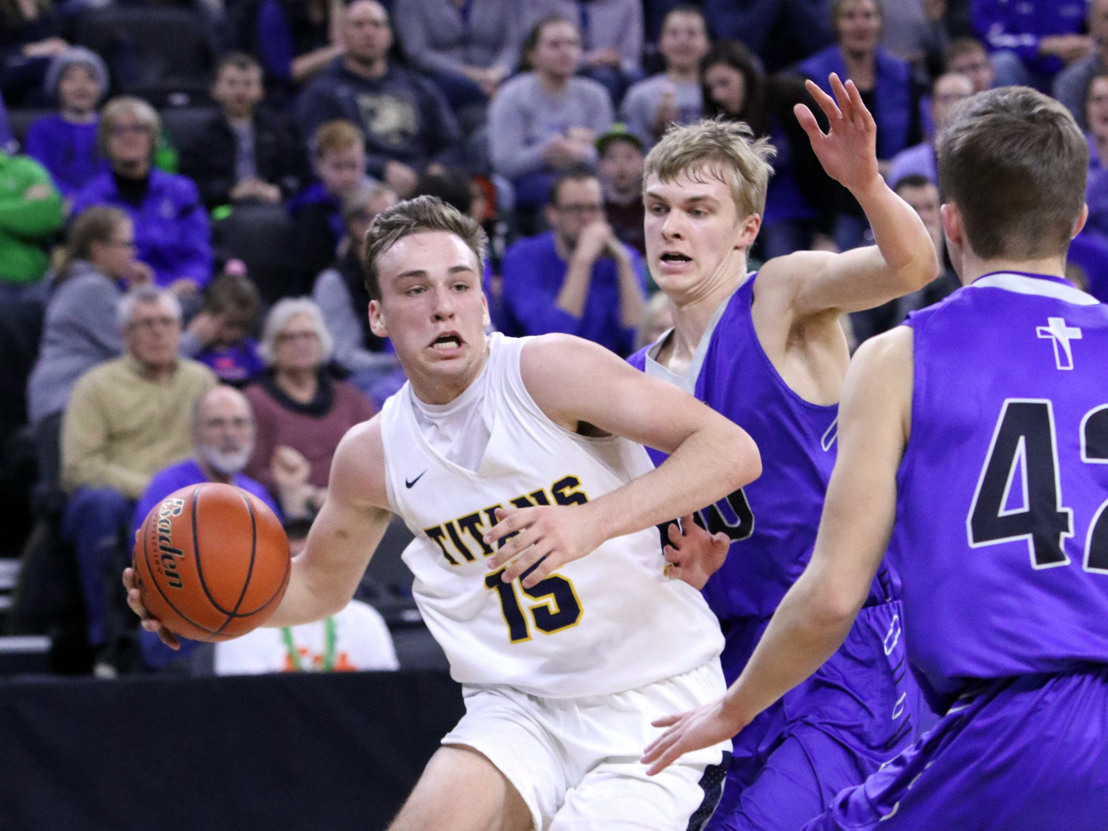 Noah Freidel of Tea Area drives the baseline against several Sioux Falls Christian defenders during Saturday's Class A title game at the Premier Center.