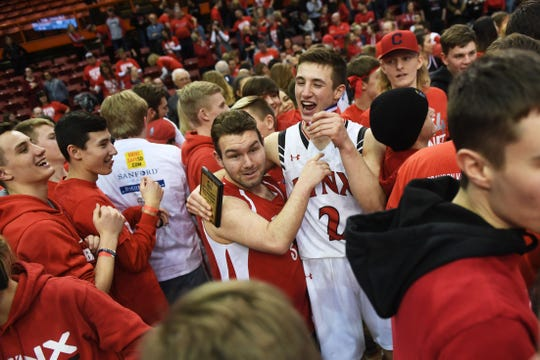Brandon Valley's Carter Olthoff celebrates with his classmates after the win against O'Gorman in the Class AA finals Saturday, March 16, in Rapid City.