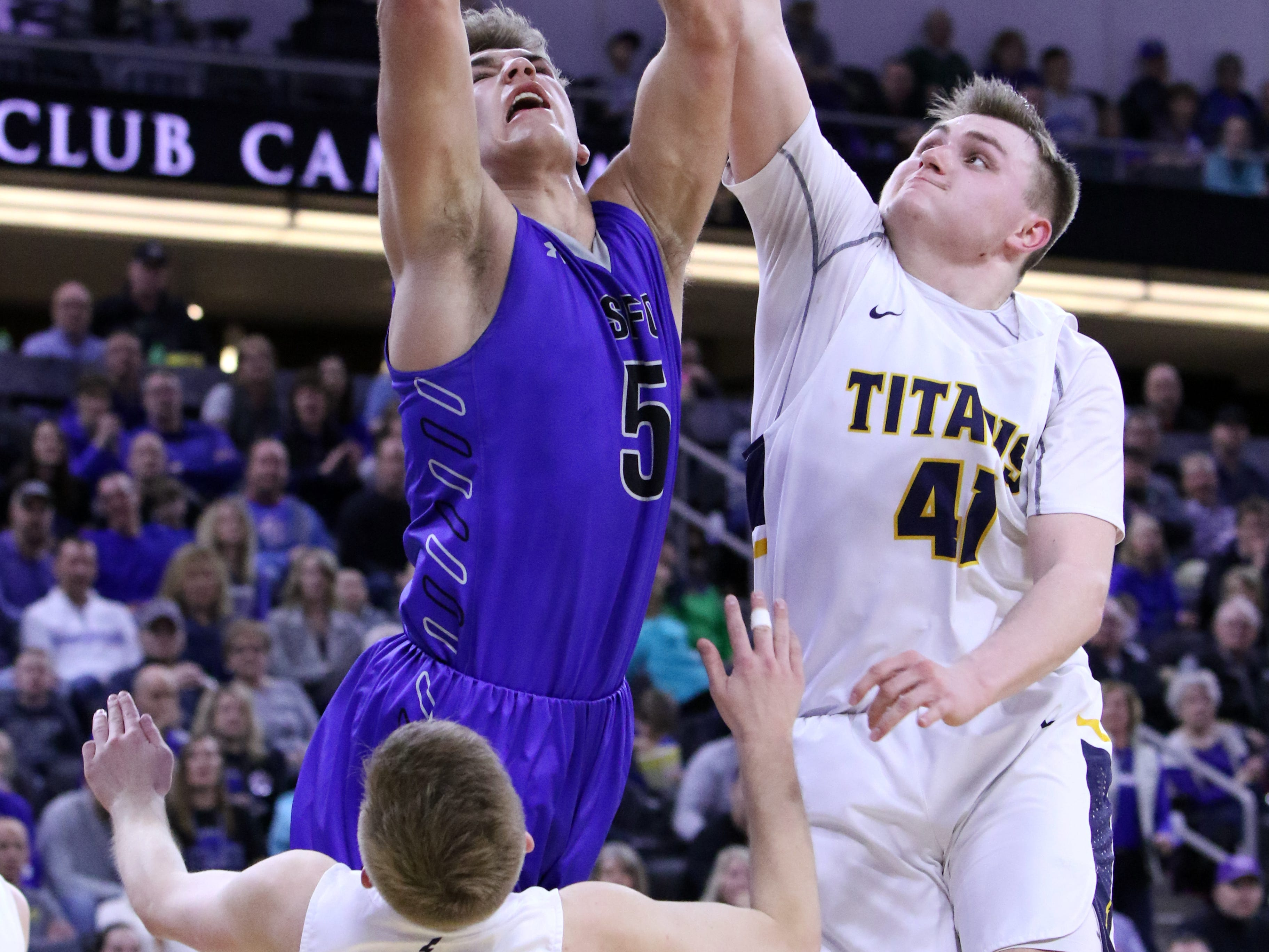 Mitchell Goodbary of Sioux Falls Christian goes up for a shot as Kaleb Joffer (41) and Mason Ritter defend during Saturday's Class A title game at the Premier Center.