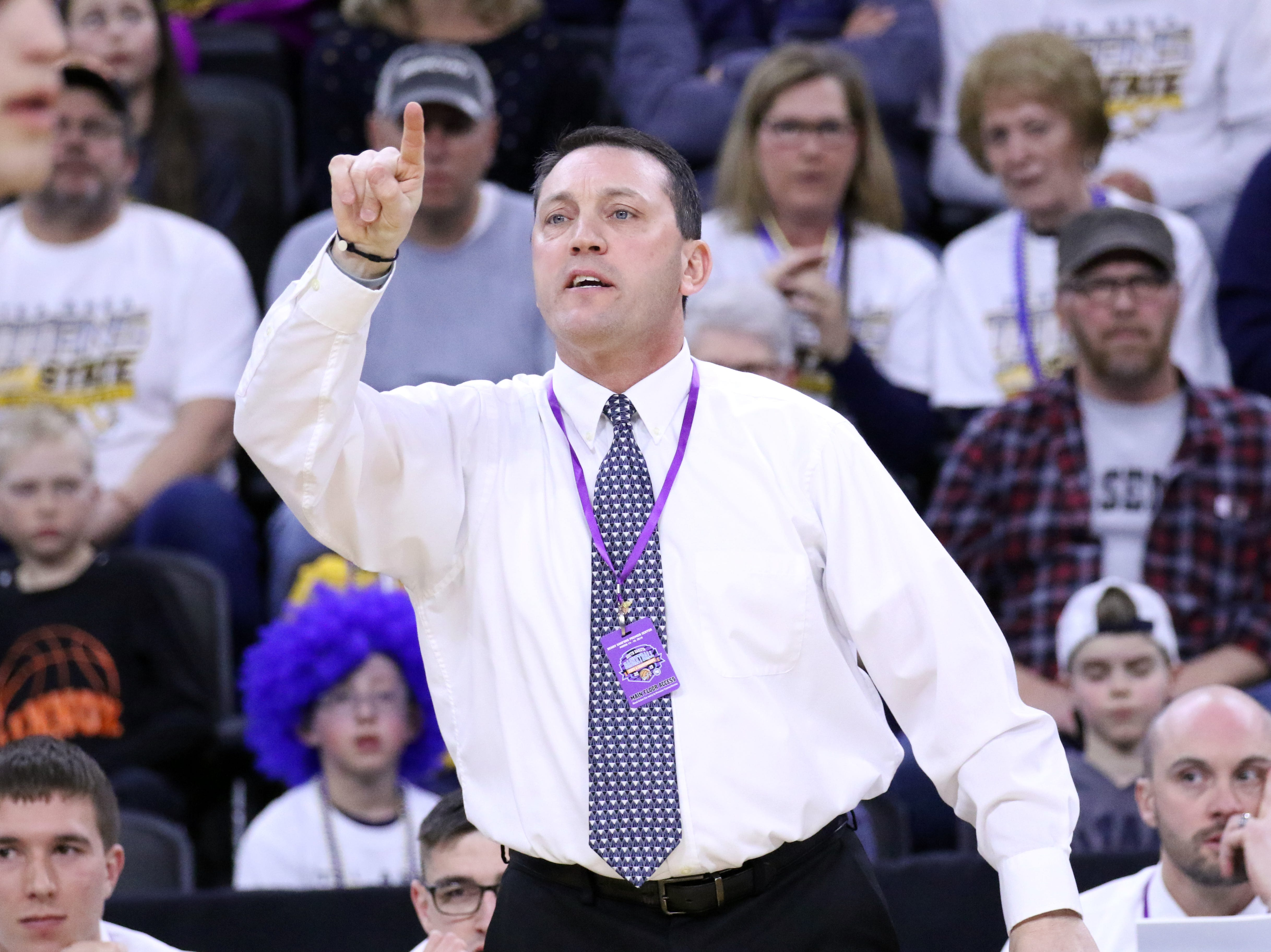 Tea Area Head Coach, Chris Fechner signals a play during Saturday's Class A championship game against Sioux Falls Christian on Saturday night at the Premier Center.