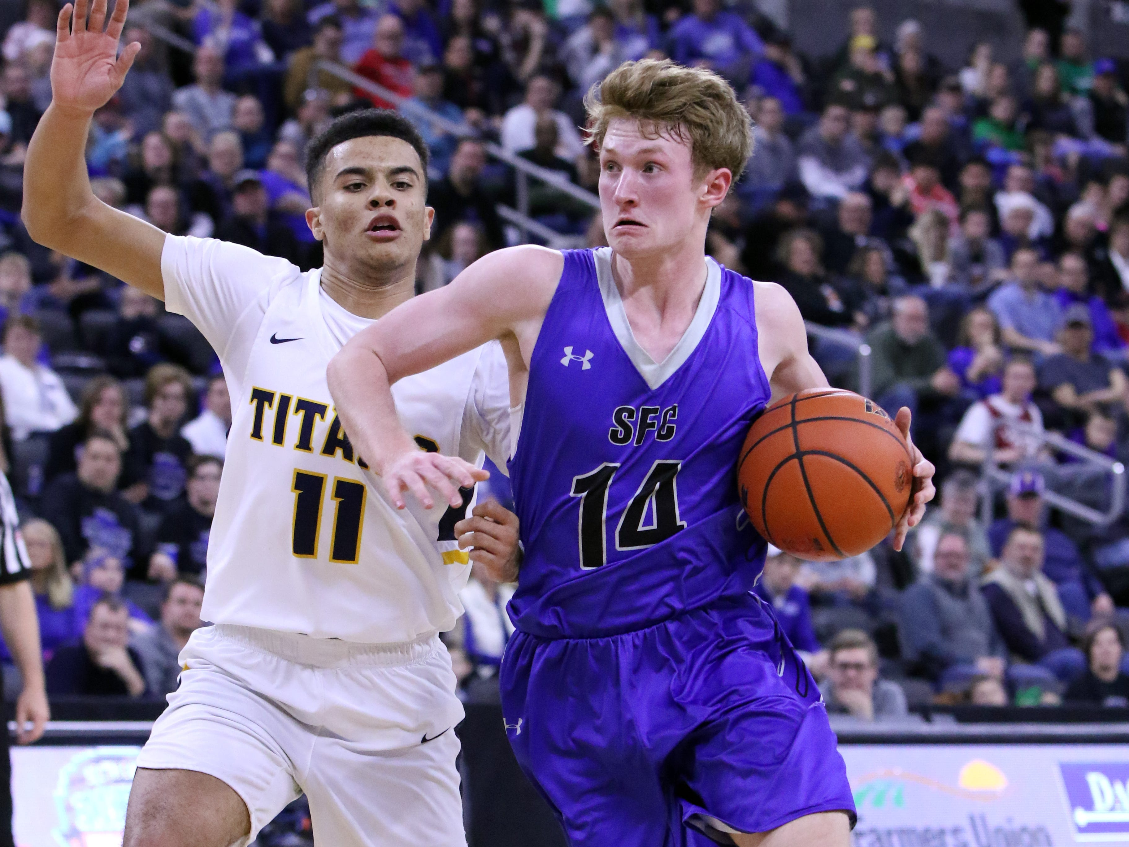 Gavin Schipper of Sioux Falls Christian drives past Justin Hohn of Tea Area during Saturday's Class A title game at the Premier Center.