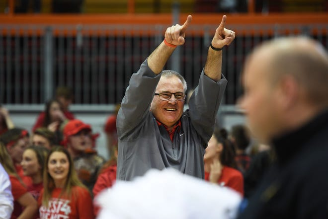 Brandon Valley Principal Gregg Talcott points to the crowd after the boys basketball team won the Class AA title against O'Gorman on Saturday, March 16, in Rapid City.