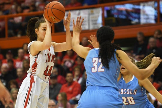 Brandon Valley's Trinity Law takes a shot against Lincoln's Sydnaya Dunn during the game in the Class AA finals Saturday, March 16, in Rapid City.