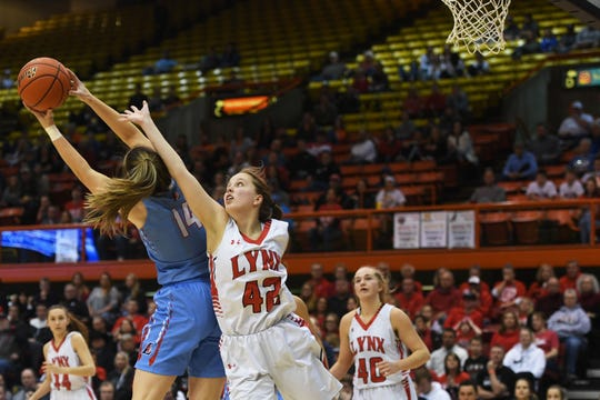 Lincoln's Emma Osmundson attempts to gain control of the ball against Brandon Valley's Ashley Wells in the Class AA finals Saturday, March 16, in Rapid City.