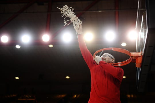 Brandon Valley's Mark Stadem cuts the net after their win against Lincoln in the Class AA finals Saturday, March 16, in Rapid City.