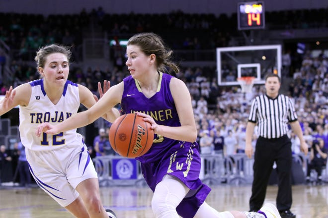 Bella Swedlund of Winner dribbles as Kali Nelson of West Central defends during the Class A championship game at the Premier Center in Sioux Falls.