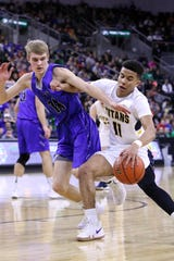 Justin Hohn of Tea Area dribbles against Mitchell Oostra of Sioux Falls Christian during Saturday's Class A title game at the Premier Center.