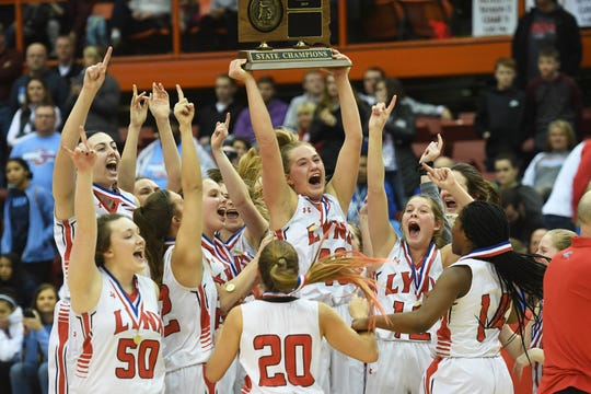 Brandon Valley celebrates their win against Lincoln in the Class AA finals Saturday, March 16, in Rapid City.