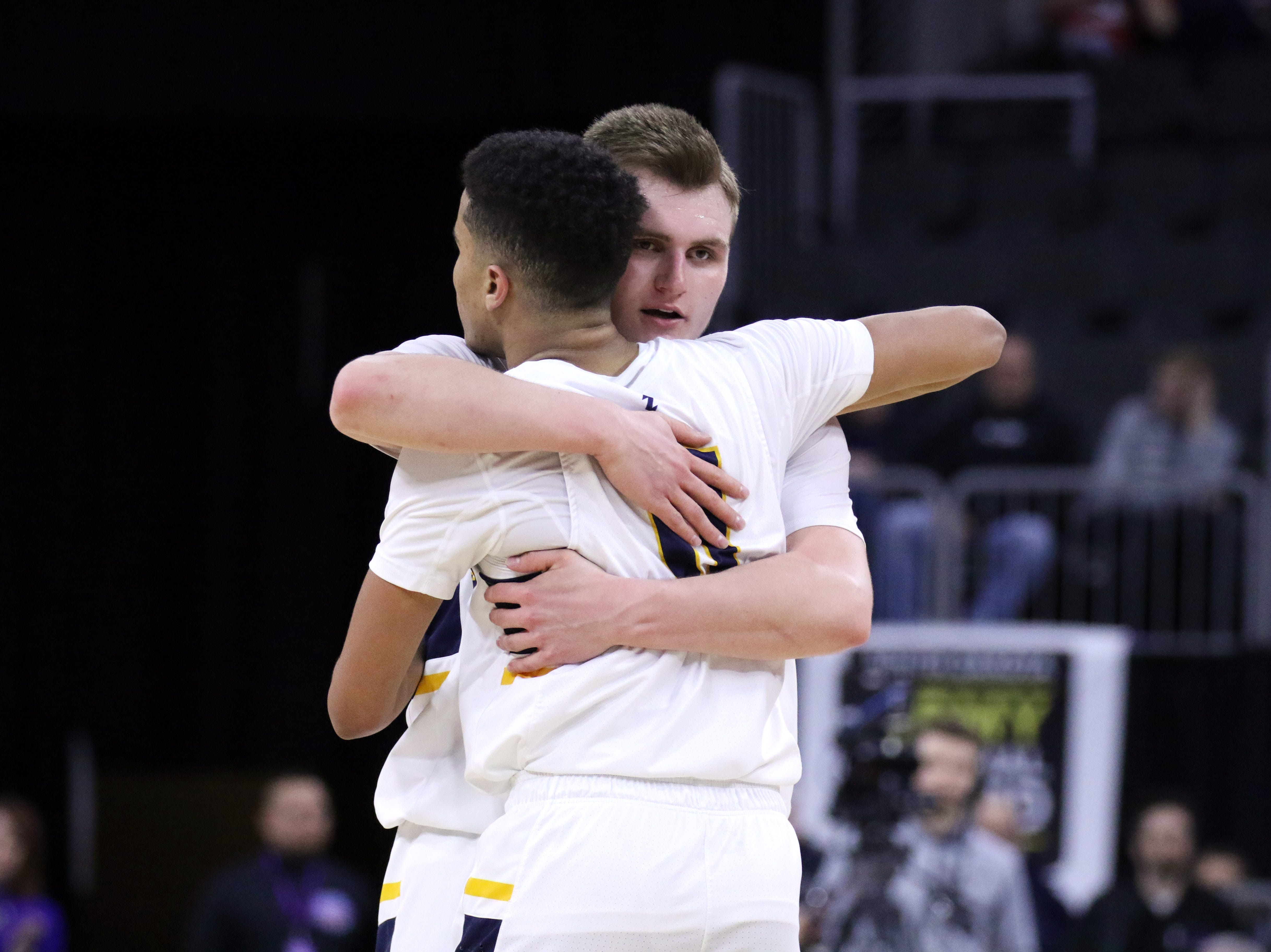 Kaleb Joffer and Justin Hohn of Tea congratulate each other after defeating Sioux Falls Christian for the Class A title on Saturday night at the Premier Center.