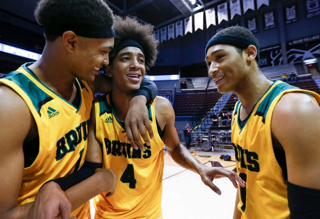 Rock Bridge's Isiaih Mosley (left) Ja'Monta Black and Dajuan Harris are overcome with emotion after winning the Class 5 state championship game at JQH Arena on Saturday, March 16, 2019.