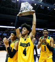 Rock Bridge's Ja'Monta Black holds the state championship trophy after the Bruins beat the Christian Brothers College Cadets in the Class 5 state championship game at JQH Arena on Saturday, March 16, 2019.
