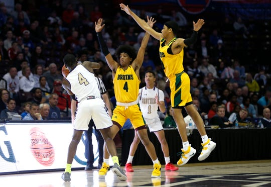 Rock Bridge's Ja'Monta Black and Dajuan Harris guard Chevalier Brenson from CBC during the Class 5 state championship game at JQH Arena on Saturday, March 16, 2019. Black and Harris are both commited to Missouri State.