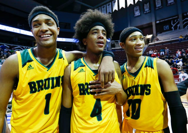 Rock Bridge's Isiaih Mosley (1), Ja'Monta Black (4) and Dajuan Harris (10) are overcome with emotion after winning the Class 5 state championship March 16, 2019, at JQH Arena in Springfield.