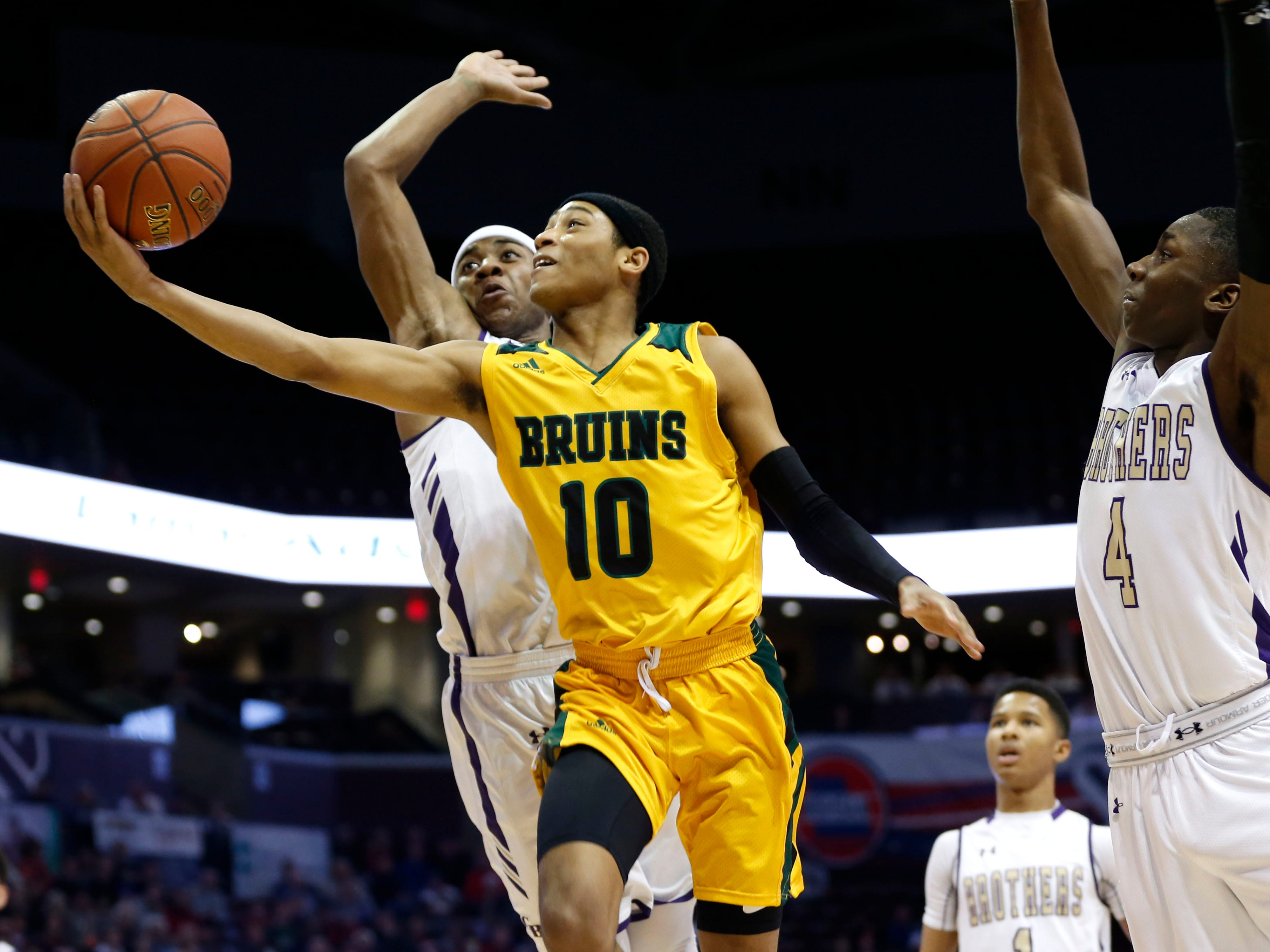 Rock Bridge's Dajuan Harris goes up for a basket during the Class 5 state championship game at JQH Arena on Saturday, March 16, 2019.