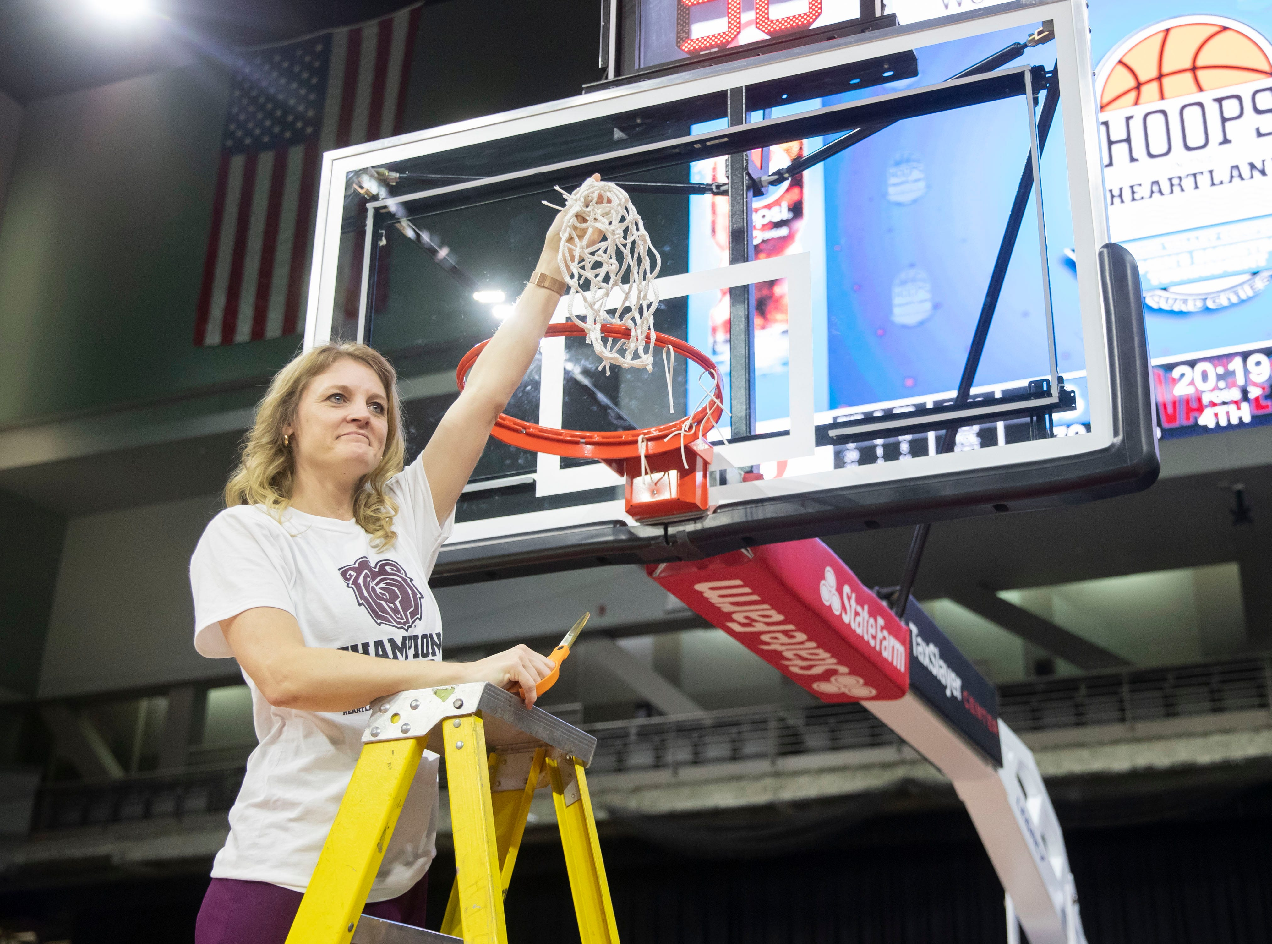 MSU head coach Kellie Harper cuts down the net after the Lady Bears defeated Drake in the final of the MVC Tournament in Moline, Ill. on Sunday, March 17, 2019.