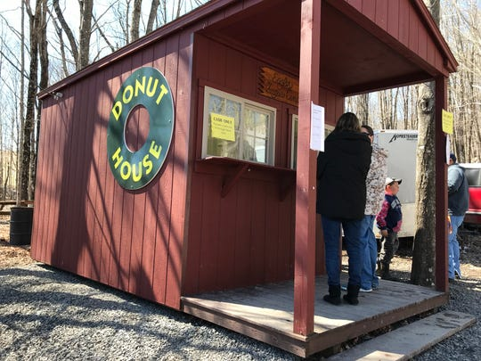 Donut House at Eagle's Sugar Camp during the 61st annual Virginia Highland Maple Festival on Sunday, March 17, 2019.