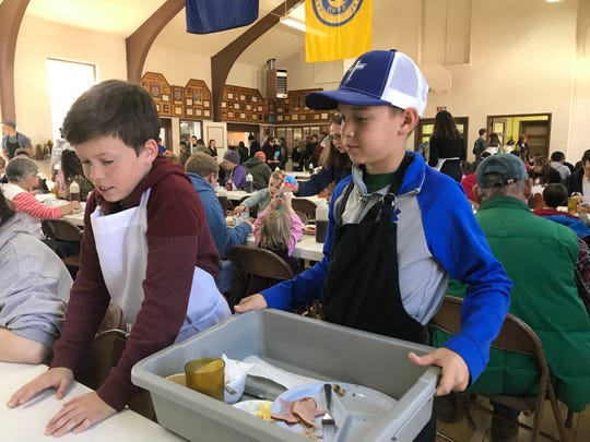 Thaddeus Chavez, 11, and Dominic Paul, 12, volunteer at Stonewall Ruritan Club's all-you-can-eat buckwheat pancake breakfast at the McDowell Community Center during the 61st annual Virginia Highland Maple Festival on Sunday, March 17, 2019.