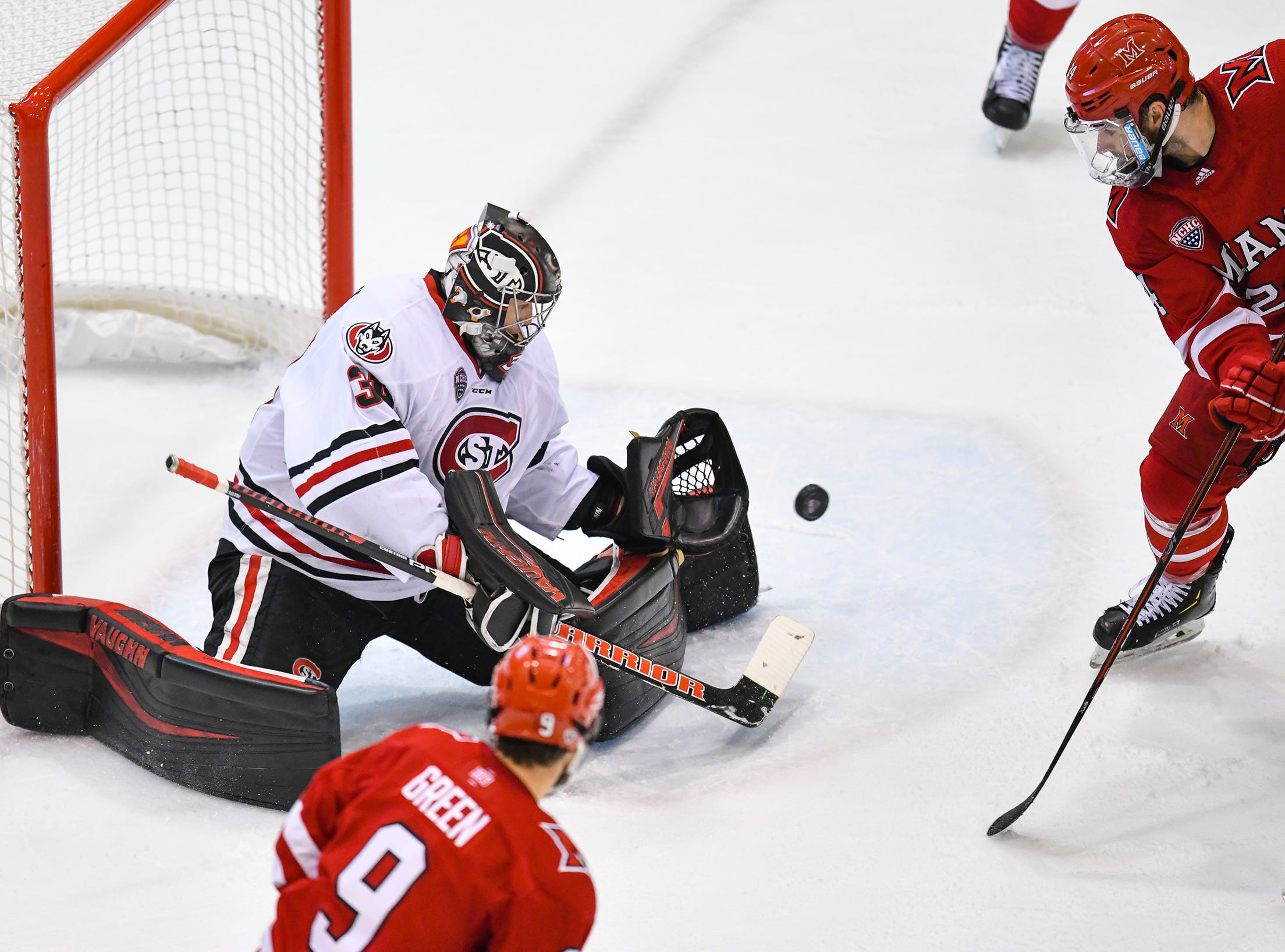 St. Cloud State goaltender David Hrenak makes a save during the second period of the Saturday, March 16 game at the Herb Brooks National Hockey Center in St. Cloud.