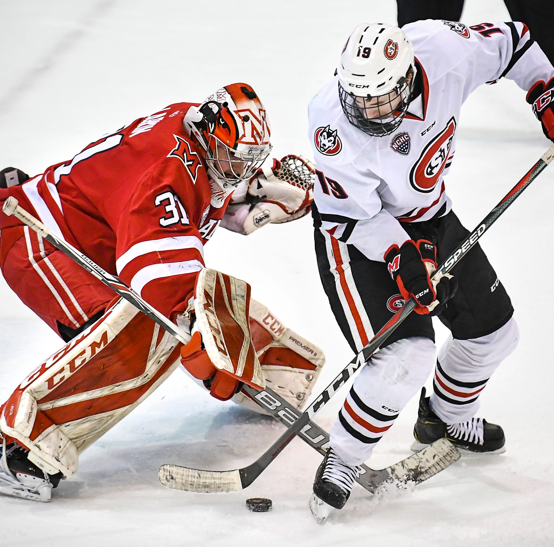 St. Cloud State's Sam Hentges takes a shot on Miami goaltender Ryan Larkin during the first period of the Saturday, March 16 game at the Herb Brooks National Hockey Center in St. Cloud.