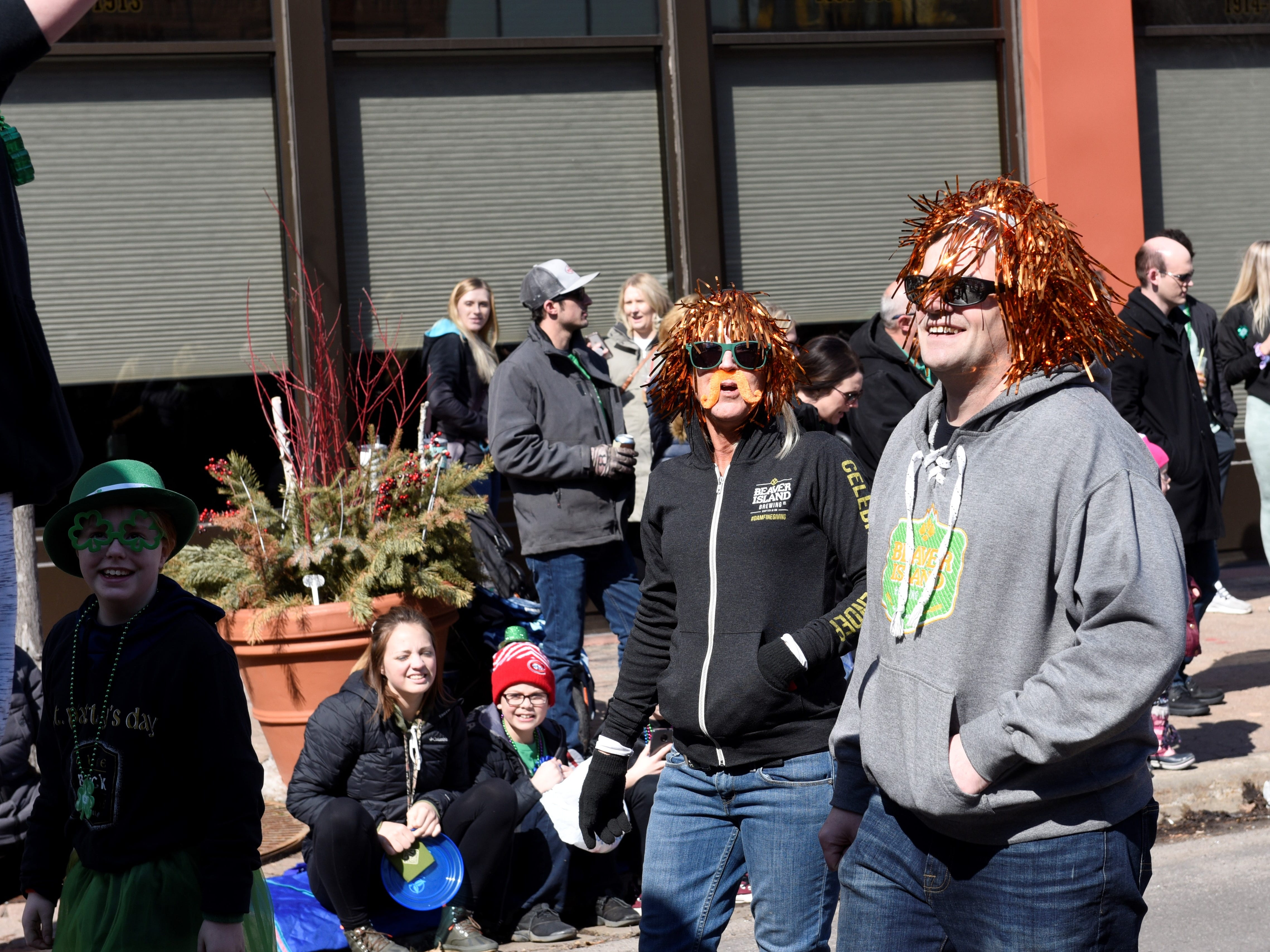 "People partake in the ""ginger parade"" at St. Cloud St. Patrick's Day parade, March 17, 2019."