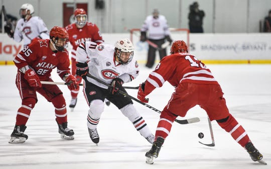 St. Cloud State's Ryan Poehling controls the puck in the Miami zone during the first period of the Saturday, March 16 game at the Herb Brooks National Hockey Center in St. Cloud.