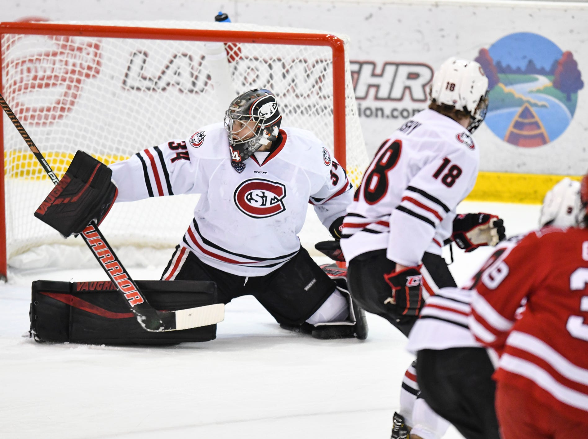 St. Cloud State goaltender David Hrenak makes a save during the first period of the Saturday, March 16 game at the Herb Brooks National Hockey Center in St. Cloud.