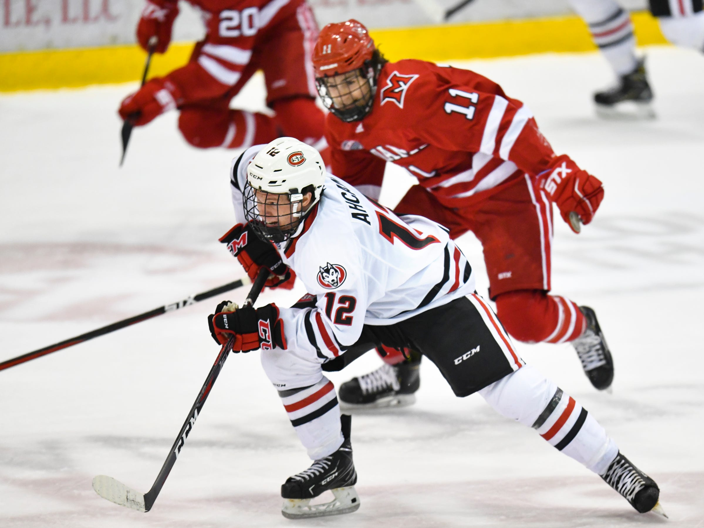 St. Cloud State's Jack Ahcan breaks away with the puck during the first period of the Saturday, March 16 game at the Herb Brooks National Hockey Center in St. Cloud.