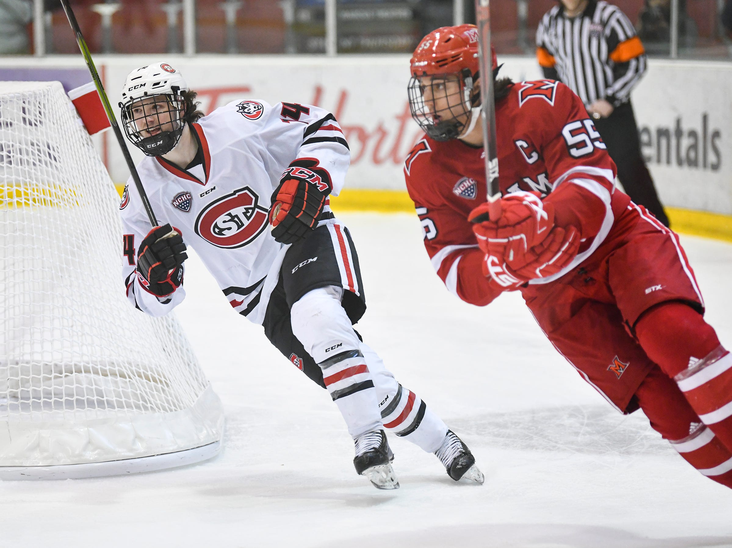 St. Cloud State's Patrick Newell skates behind the Miami goal during the first period of the Saturday, March 16 game at the Herb Brooks National Hockey Center in St. Cloud.