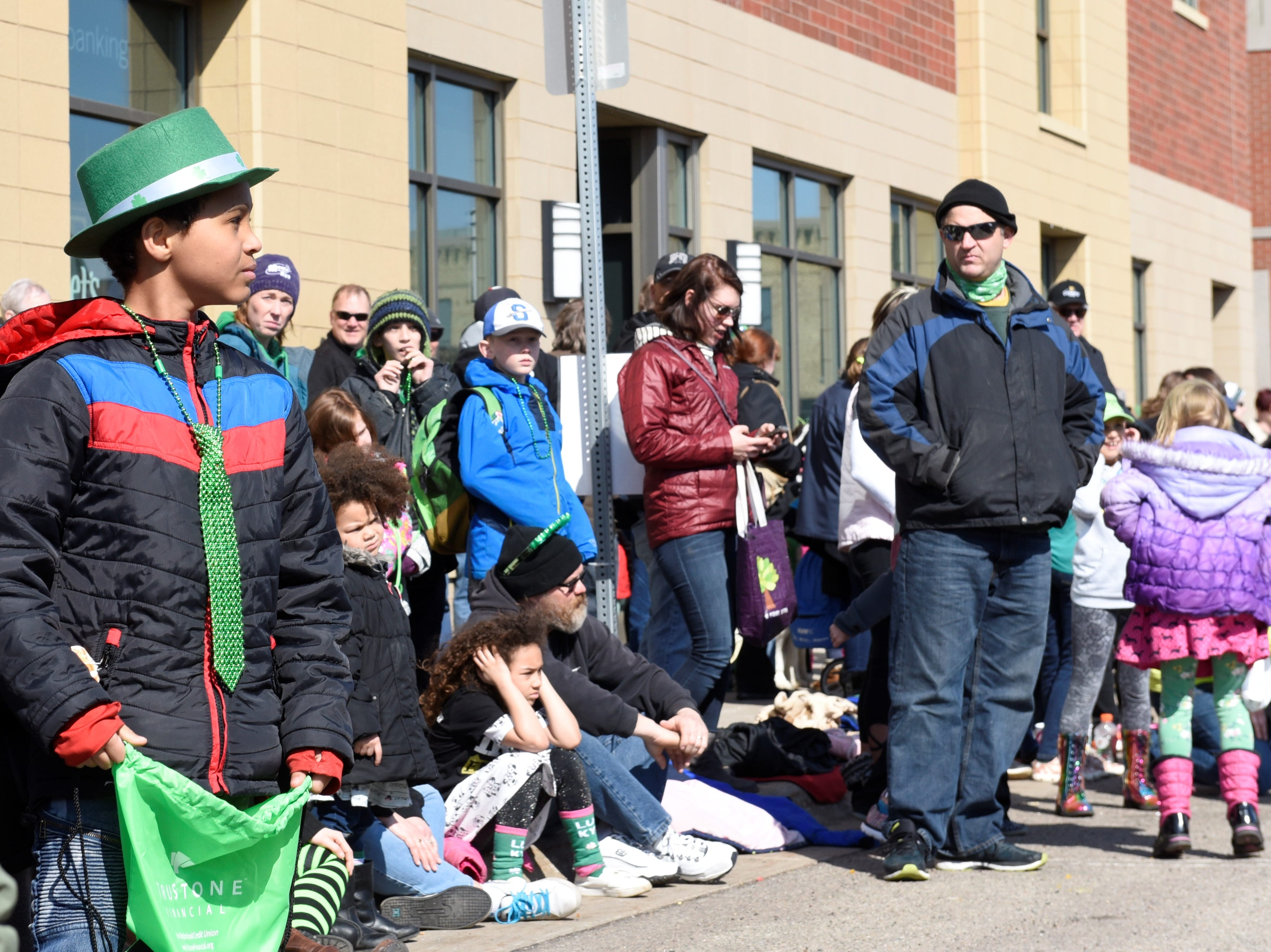 Kids hope for candy as they watch the St. Patrick's Day parade go by March 17, 2019.