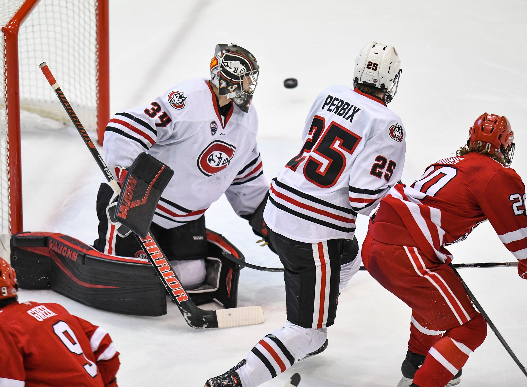 The puck flies past St. Cloud State goaltender David Hrenak during the second period of the Saturday, March 16 game at the Herb Brooks National Hockey Center in St. Cloud.
