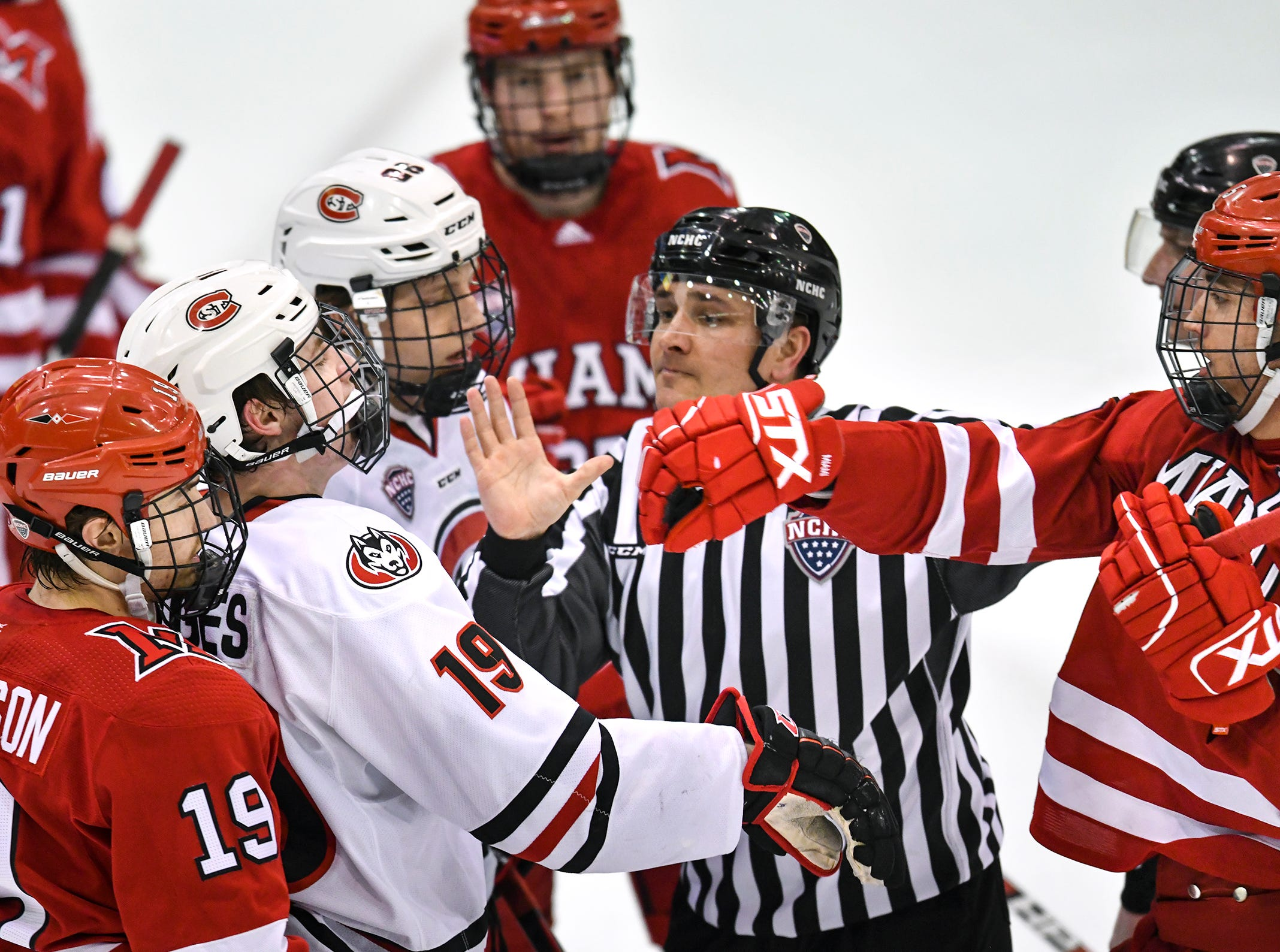 Players gather near the Miami goal during the first period of the Saturday, March 16 game at the Herb Brooks National Hockey Center in St. Cloud.