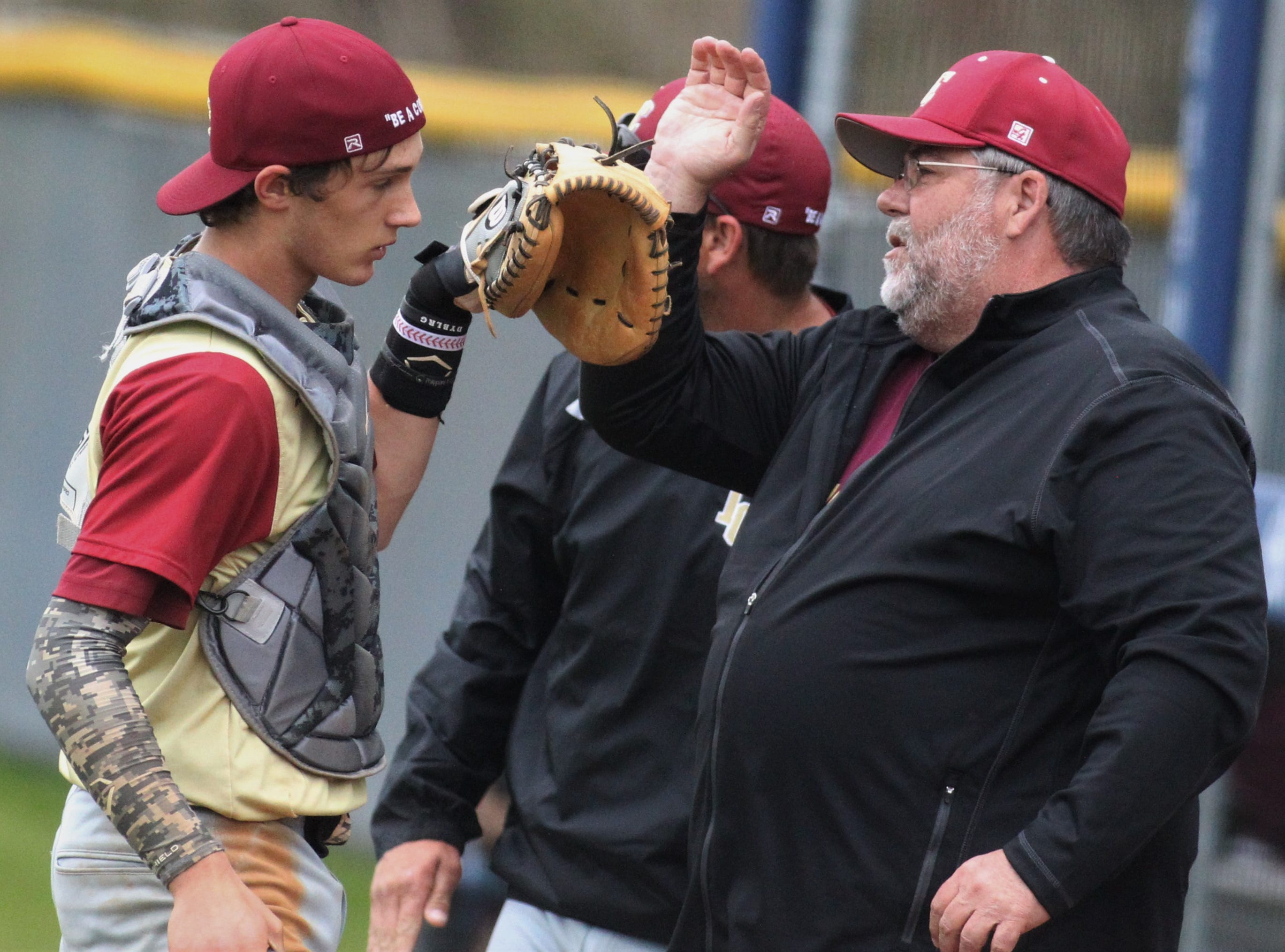 Liberty County catcher Austin Waller gets congratulated as Liberty County's baseball team went on the road to beat Maclay 8-2 on Saturday, March 16, 2019. The Bulldogs played their first game following their head coach Corey Crum's tragic death six days ago.