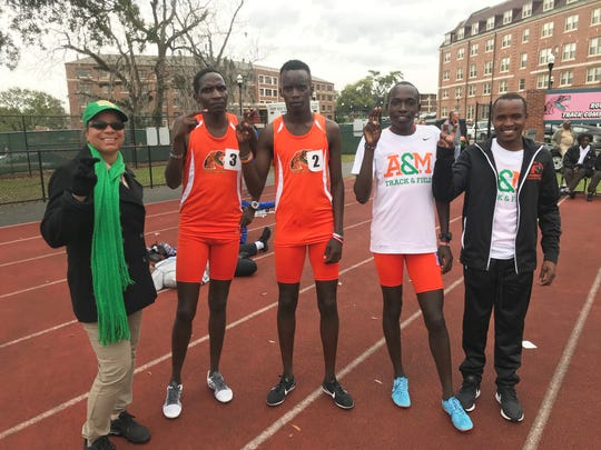 """From left to right: Track and field head coach Darlene Moore, Jacob Nkamasiai (3), Brian Kiprop (2), Fredrick Kipyego and Festus Kemboi """"Strike"""" a pose at the FAMU Relays on Saturday, March 16, 2019."""
