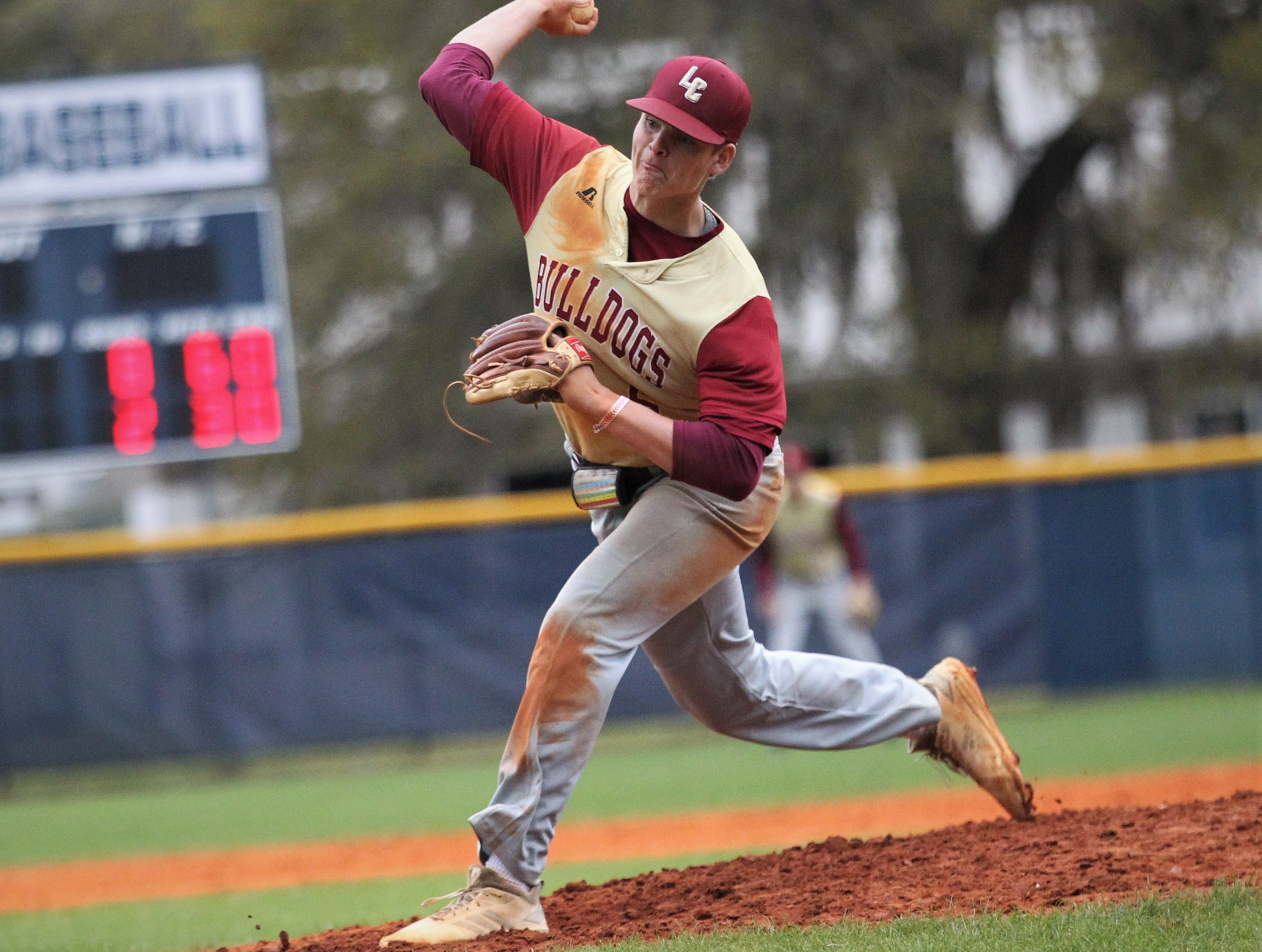 Liberty County's Brice Dillmore pitches in relief as Liberty County's baseball team went on the road to beat Maclay 8-2 on Saturday, March 16, 2019. The Bulldogs played their first game following their head coach Corey Crum's tragic death six days ago.
