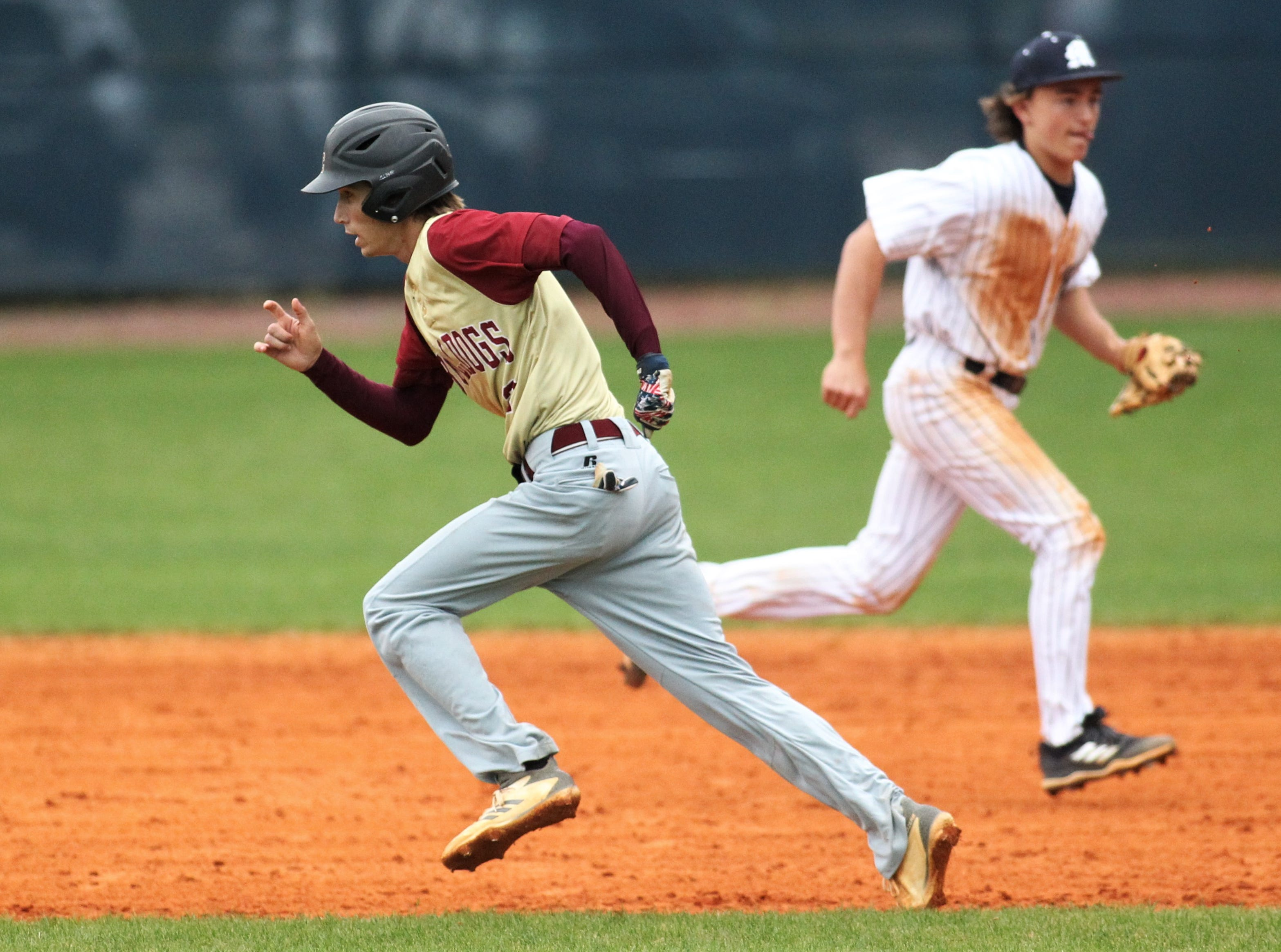 Liberty County's Brent Fant takes off for second as Liberty County's baseball team went on the road to beat Maclay 8-2 on Saturday, March 16, 2019. The Bulldogs played their first game following their head coach Corey Crum's tragic death six days ago.