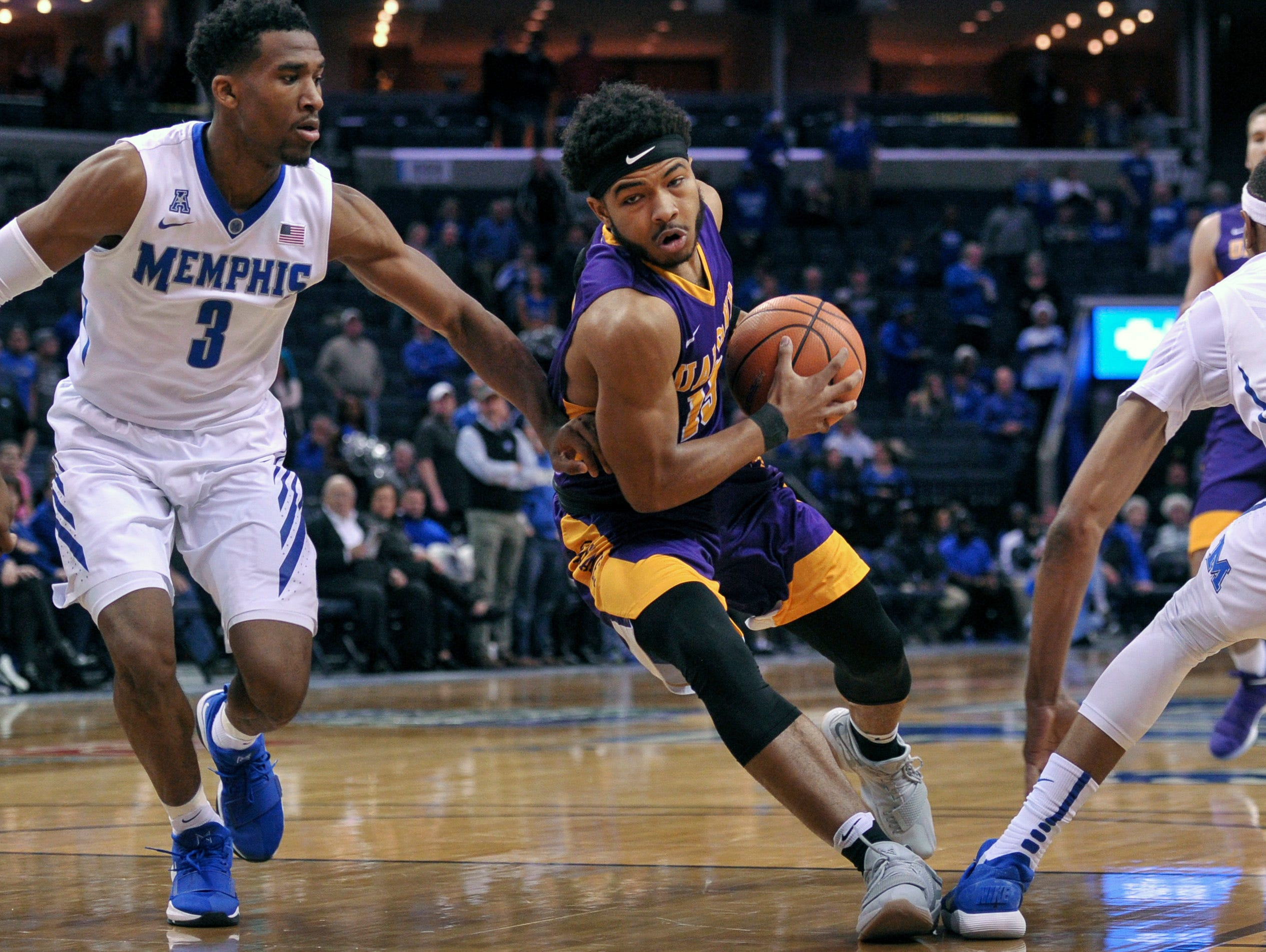 Dec 12, 2017; Memphis, TN, USA; Albany Great Danes guard David Nichols (13) goes to the basket against Memphis Tigers guard Jeremiah Martin (3) during the first half at FedExForum. Mandatory Credit: Justin Ford-USA TODAY Sports