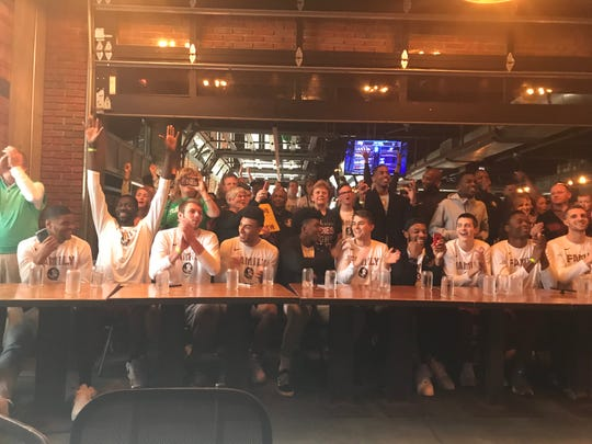 The FSU men's basketball team celebrates being named the No. 4 seed in the NCAA Tournament at Madison Social.