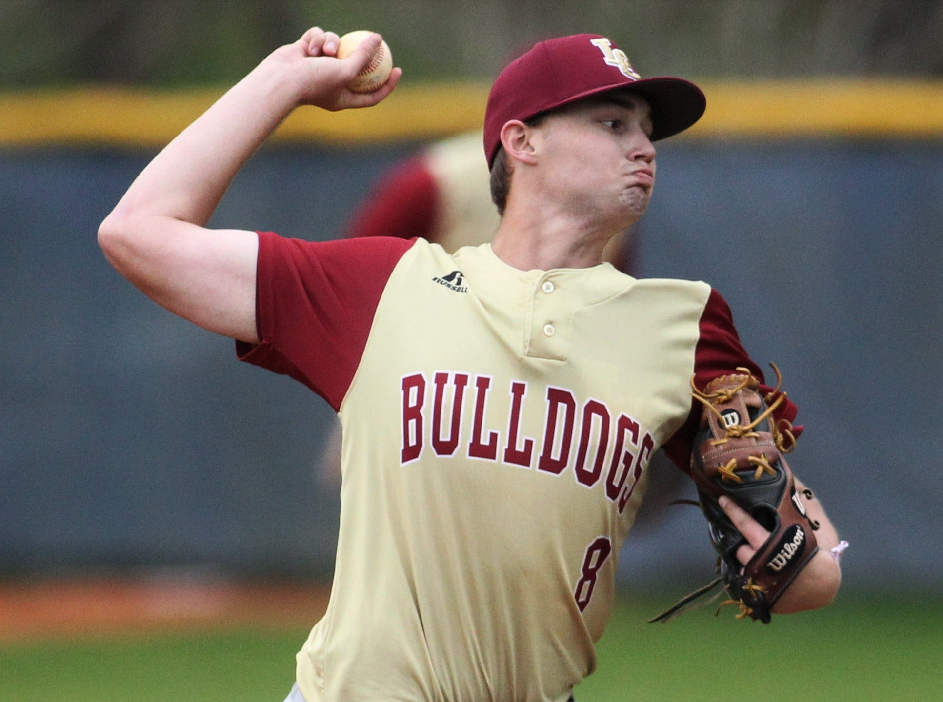 Liberty County's Hunter Sanford pitches in relief as Liberty County's baseball team went on the road to beat Maclay 8-2 on Saturday, March 16, 2019. The Bulldogs played their first game following their head coach Corey Crum's tragic death six days ago.