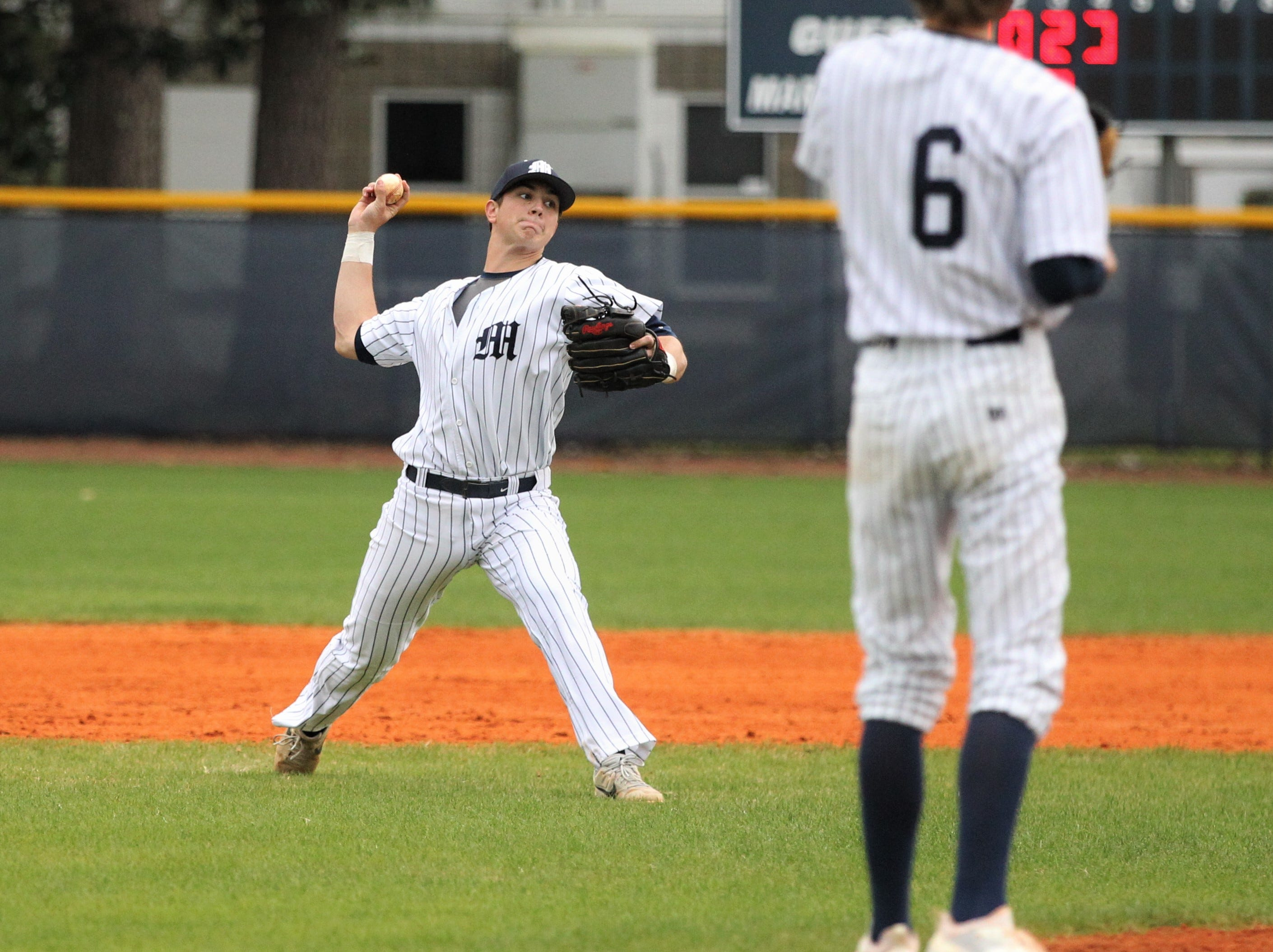 Maclay third baseman Jason Norris throws to first as Liberty County's baseball team went on the road to beat Maclay 8-2 on Saturday, March 16, 2019. The Bulldogs played their first game following their head coach Corey Crum's tragic death six days ago.