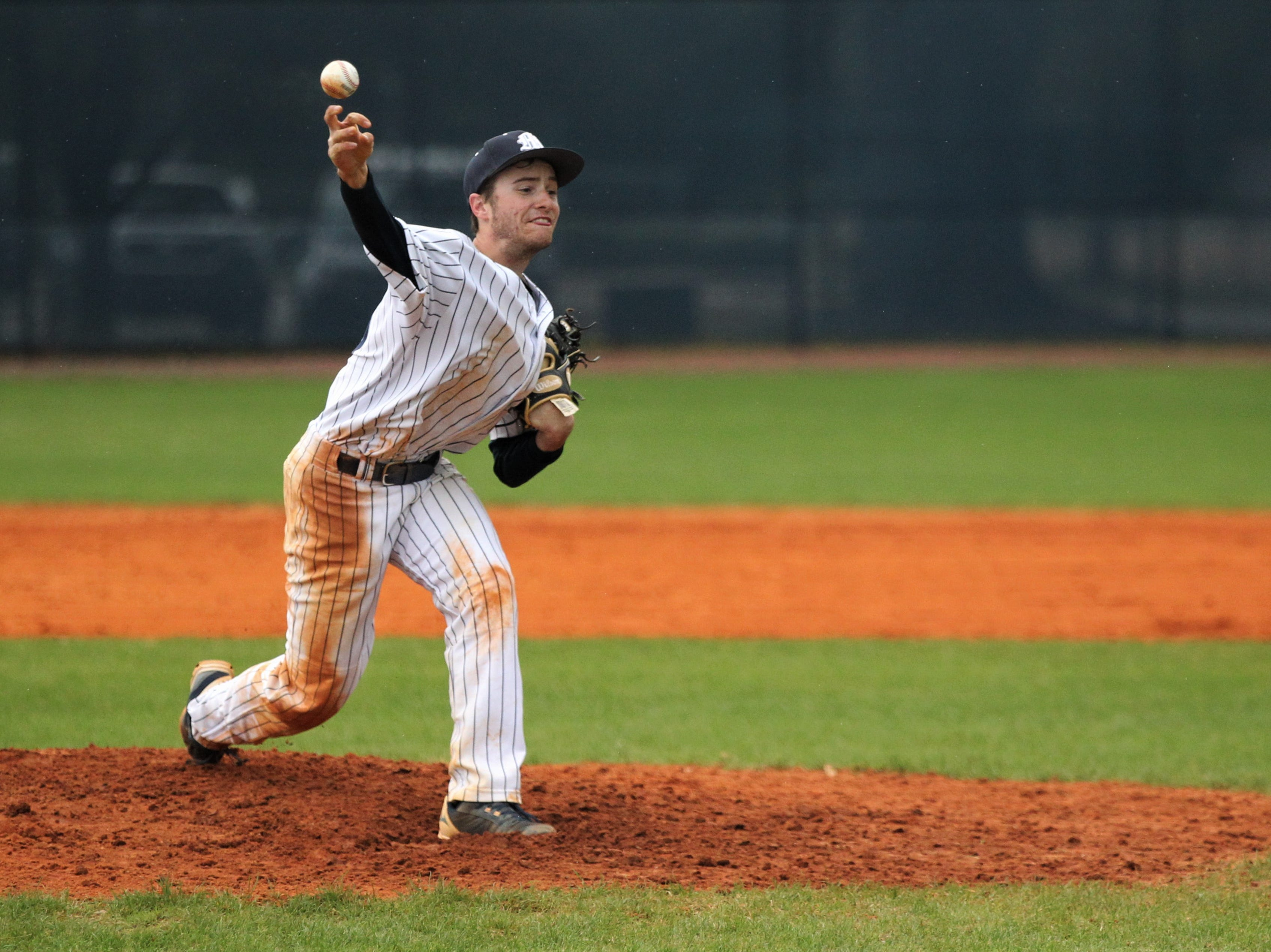 Maclay's Grant Harrison pitches as Liberty County's baseball team went on the road to beat Maclay 8-2 on Saturday, March 16, 2019. The Bulldogs played their first game following their head coach Corey Crum's tragic death six days ago.