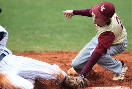 Liberty County pitcher Brent Fant tags out Maclay's Grant Harrison on a play at the plate as Liberty County's baseball team went on the road to beat Maclay 8-2 on Saturday, March 16, 2019. The Bulldogs played their first game following their head coach Corey Crum's tragic death six days ago.