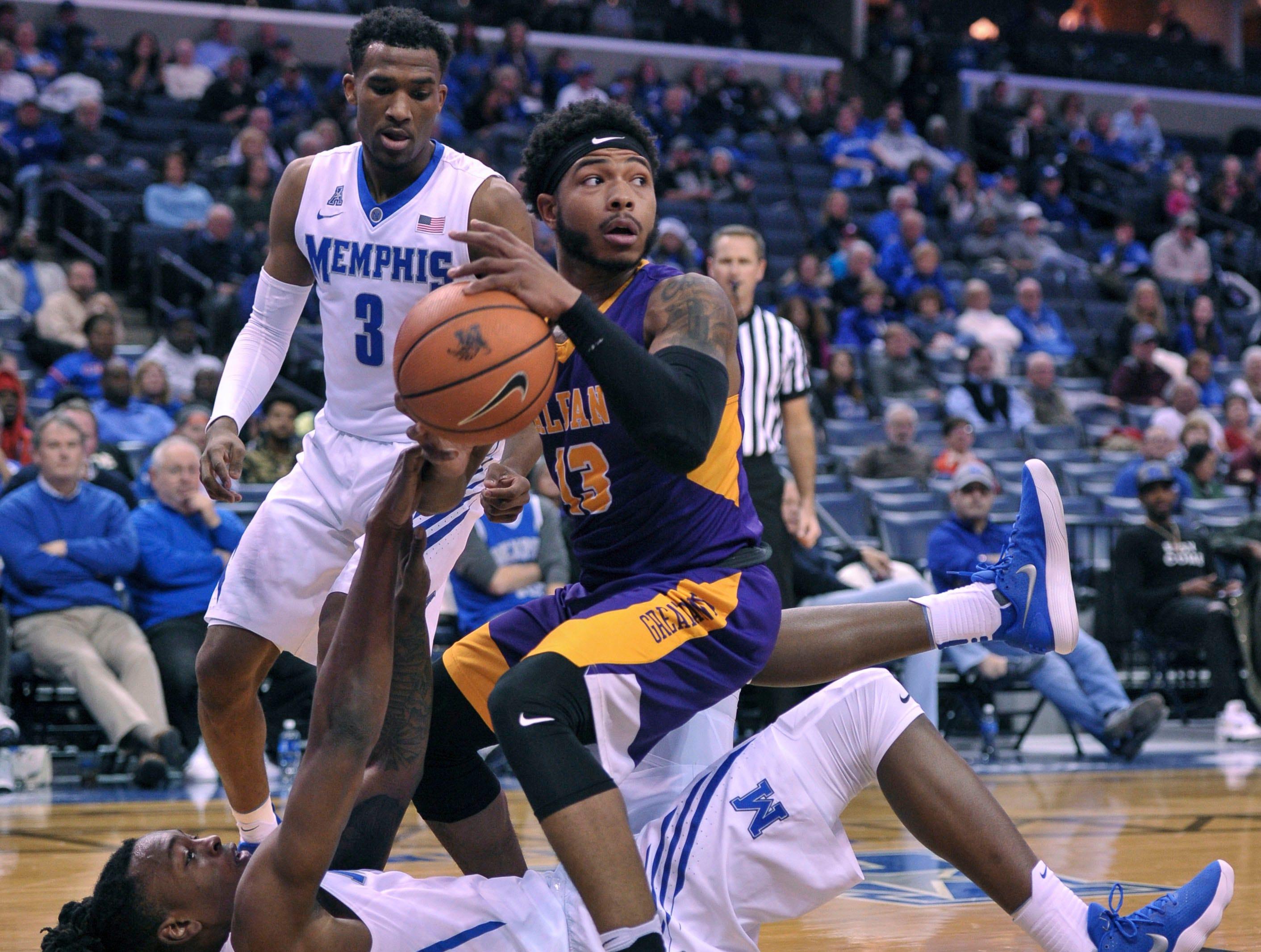 Dec 12, 2017; Memphis, TN, USA; Albany Great Danes guard David Nichols (13) and Memphis Tigers forward Kyvon Davenport (0) fight for the ball during the first half at FedExForum. Mandatory Credit: Justin Ford-USA TODAY Sports