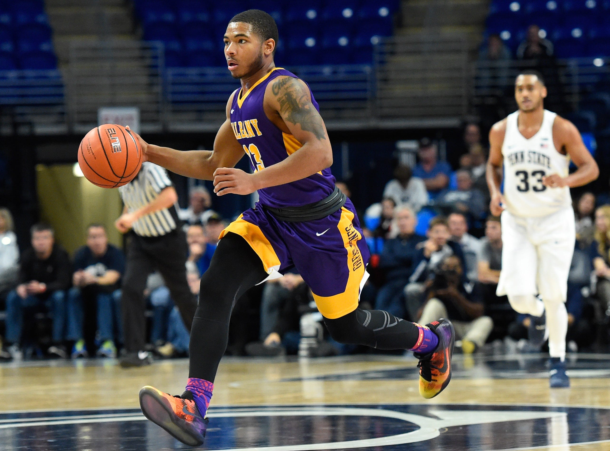 Nov 11, 2016; University Park, PA, USA; Albany Great Danes guard David Nichols (13) dribbles up the court against the Penn State Nittany Lions during the second half at the Bryce Jordan Center. Albany defeated Penn State 87-81. Mandatory Credit: Rich Barnes-USA TODAY Sports