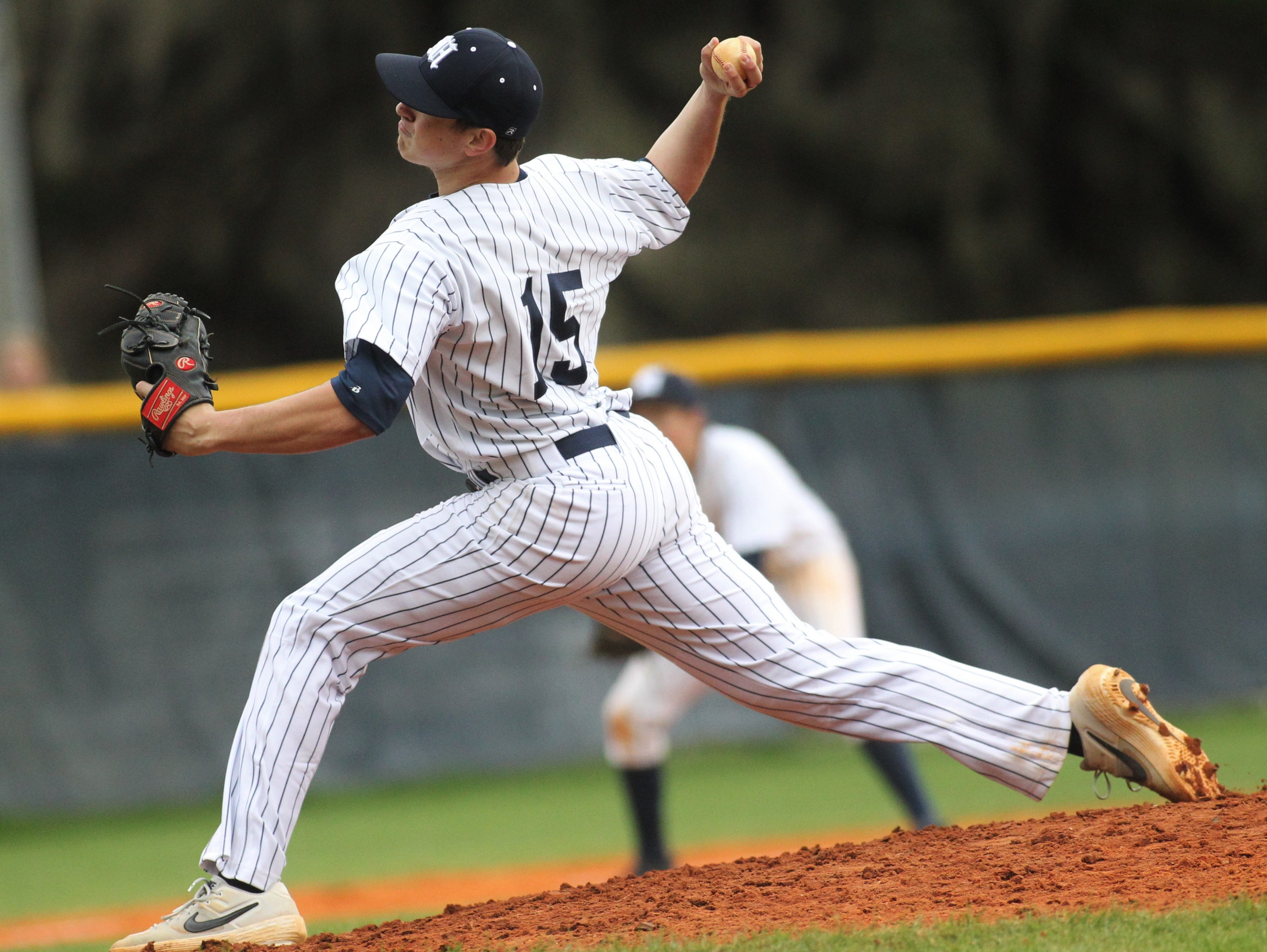 Maclay senior Jason Norris pitches in relief as Liberty County's baseball team went on the road to beat Maclay 8-2 on Saturday, March 16, 2019. The Bulldogs played their first game following their head coach Corey Crum's tragic death six days ago.