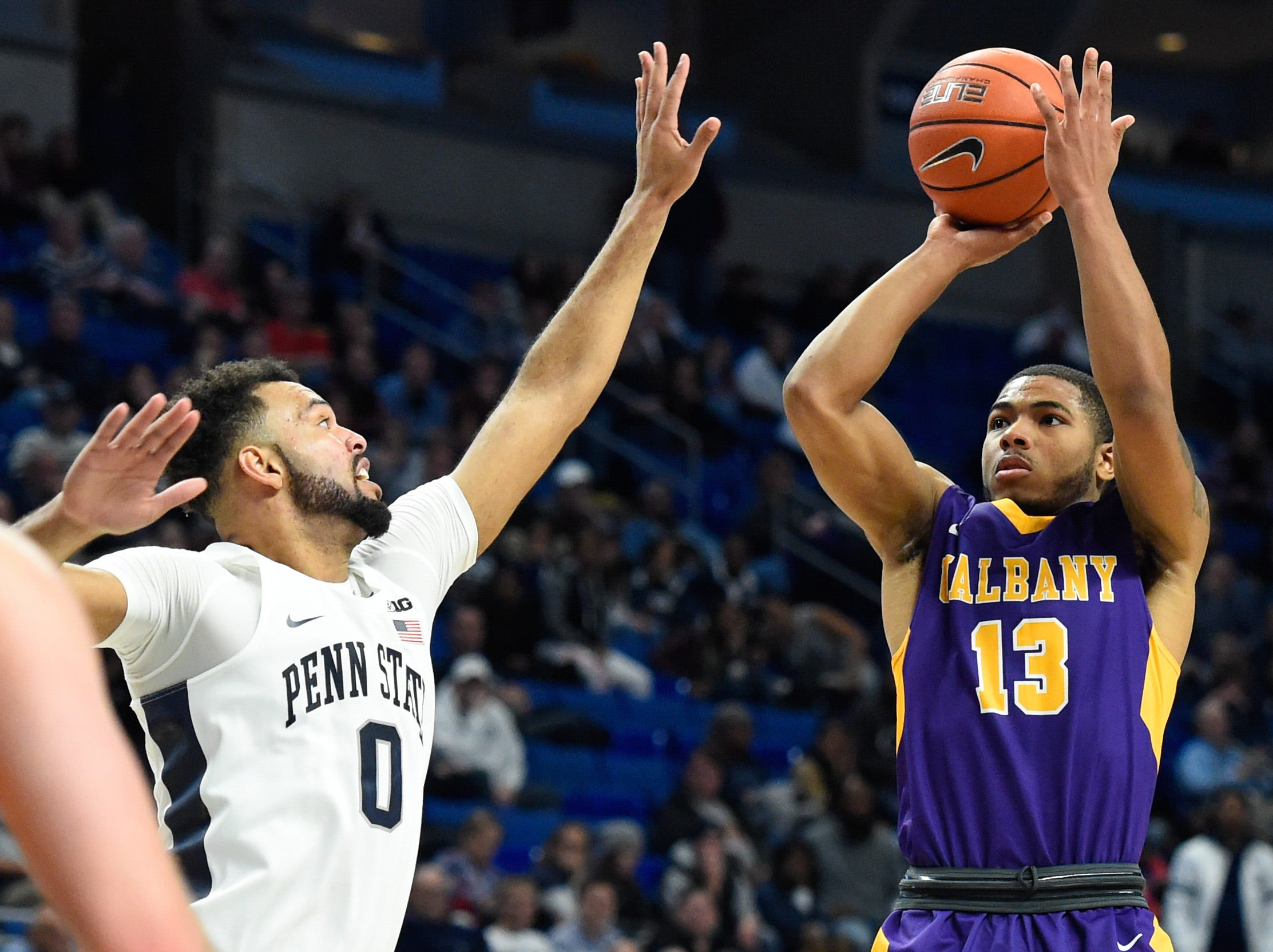 Nov 11, 2016; University Park, PA, USA; Albany Great Danes guard David Nichols (13) shoots the ball against the defense of Penn State Nittany Lions forward Payton Banks (0) during the second half at the Bryce Jordan Center. Albany defeated Penn State 87-81. Mandatory Credit: Rich Barnes-USA TODAY Sports